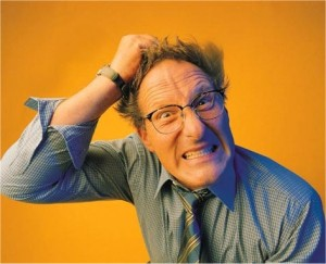 Image of a fustrated man tearing his hair out
