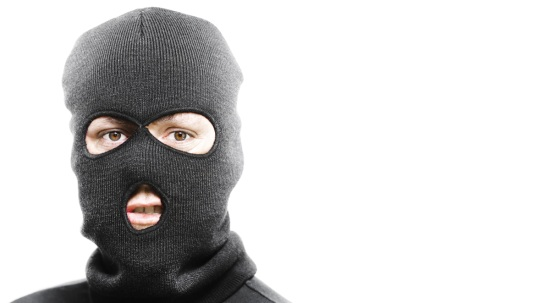 person in a balaclava to symbolise blackmail