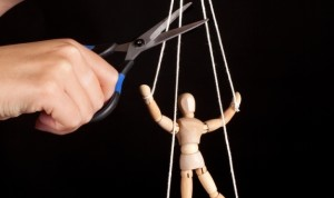 wooden marionette to symbolise strings-attached
