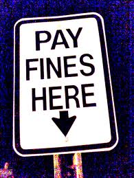 White sign  with black writing Pay fine here
