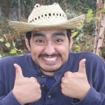 mexican guy in straw trilby with thumbs up