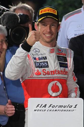 Jenson-Button thumbs up McLaren F1 driver